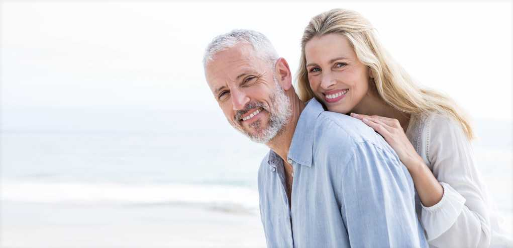 Portrait of Mature Couple on the Beach After Active-Fx-Deep-Fx-Fractional-CO2 Treatment.