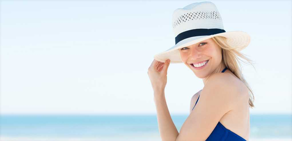 Beautiful Lady Spending Time on the Beach after Laser Hair Removal Treatment.