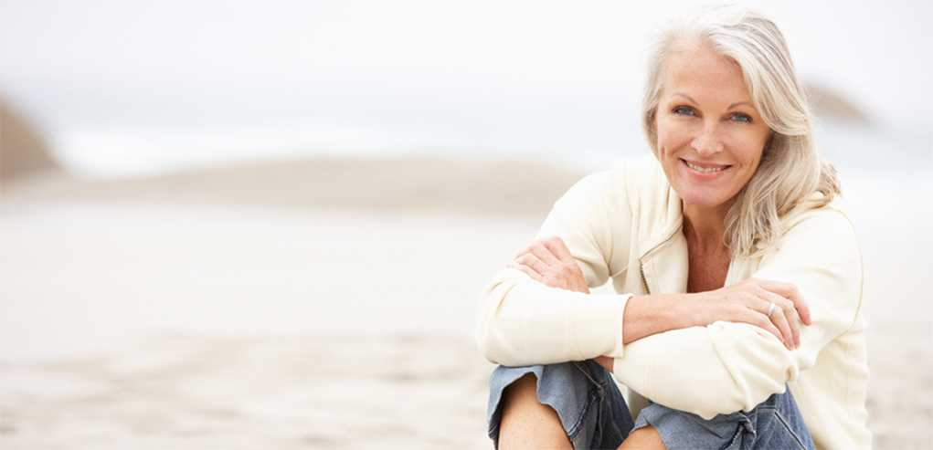 Lady Sitting on the Beach Content with the Skin Cancer Treatment Received.